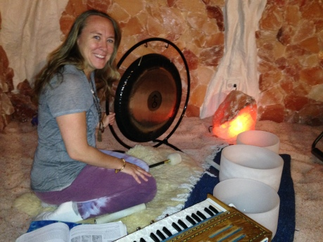 Jenny playing her gong, harmonium, and crystal bowls.