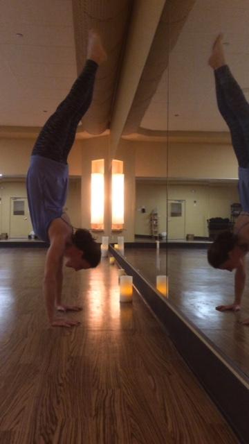 Jacqueline practicing her favorite pose, handstand.