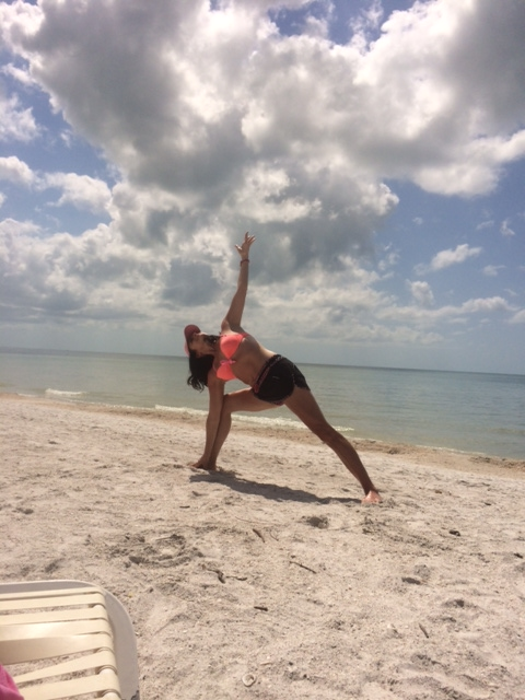 Lisa blissing out doing some beach yoga.